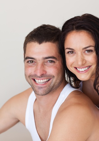 thirty���s: Handsome couple smiling at camera Stock Photo