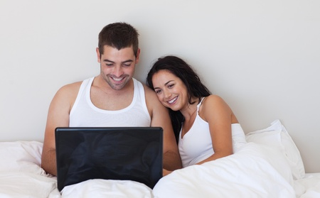 Husband and wife using a laptop  photo