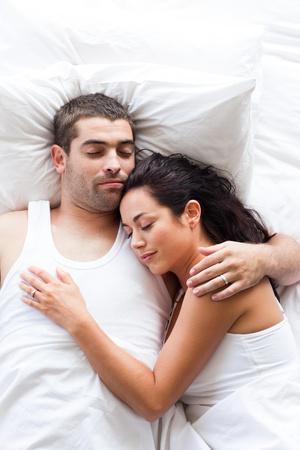 Attractive couple sleeping  photo
