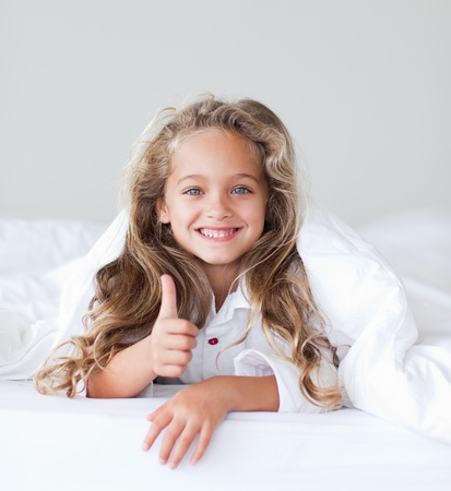 Portrait of a beautiful girl thumbs up photo