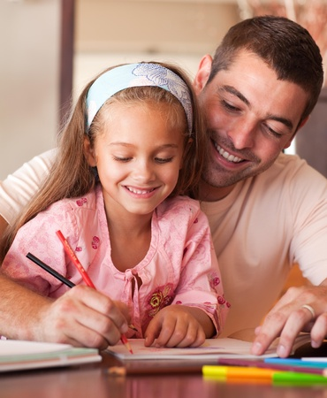 Concentrated smiling girl painting Stock Photo - 10074845