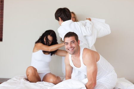 Attractive man having fun with his family  photo