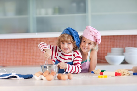 smiling siblings in the kitchen photo