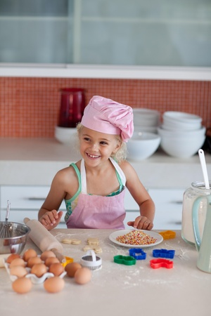 beautiful young girl working in the kitchen photo