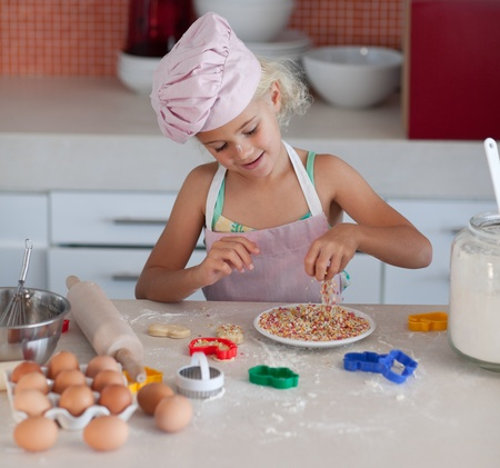 pretty young girl working in the kitchen  photo