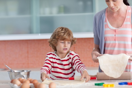 concentrated boy baking  Stock Photo - 10074942