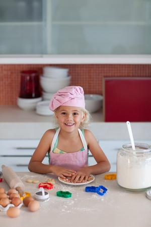 little blond girl smiling at camera photo