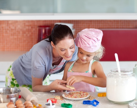young mother teaching child how to cook  photo