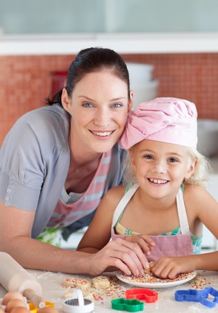happy mother and daughter  in the kitchen  photo
