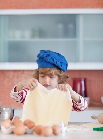 Little boy with dough photo