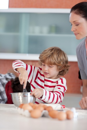 Little boy working in the kitchen Stock Photo - 10074839