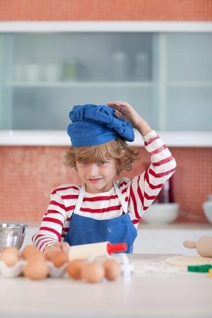 Positive little boy with a blue cap photo