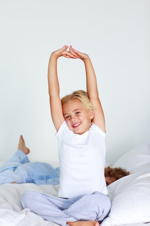 Beautiful young child stretching  photo