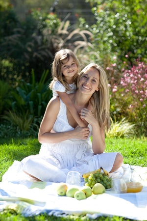 Handsome young mother with her daugther   photo