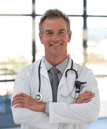 Smiling doctor with folded arms  photo