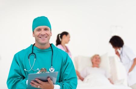Cofident surgeon with his team  photo