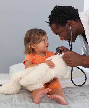 Pediatrician talking to a little girl photo