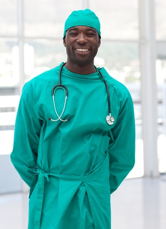 Charming doctor in green scrubs photo