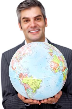 Mature businessman holding a terrestrial globe  photo