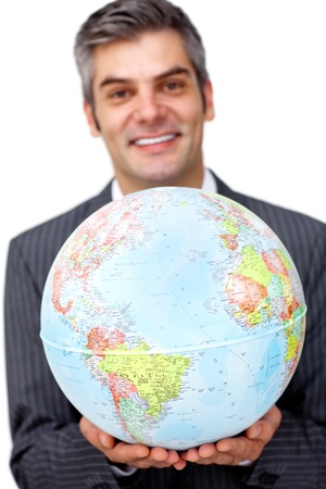 online internet presence: Mature businessman holding a terrestrial globe  Stock Photo