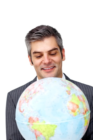 Confident businessman smiling at global business expansion  photo