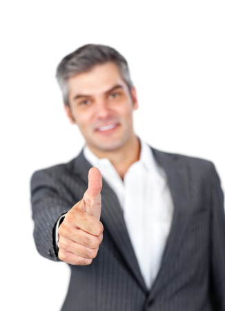 Mature businessman with thumb up  photo