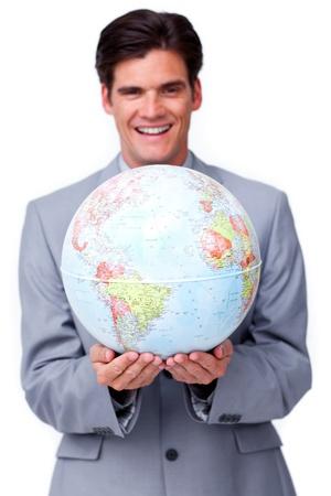 online internet presence: Charismatic businessman holding a terrestrial globe  Stock Photo