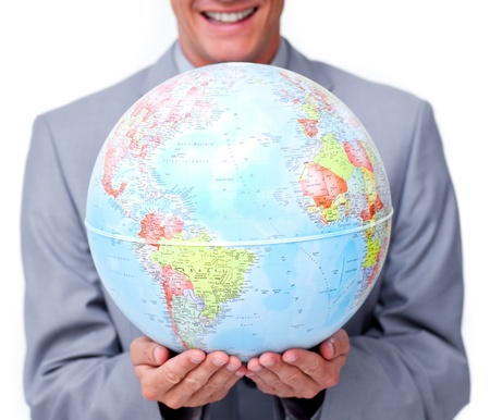 online internet presence: Close-up of a businessman holding a terrestrial globe  Stock Photo