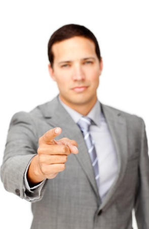 Serious businessman pointing at the camera  photo