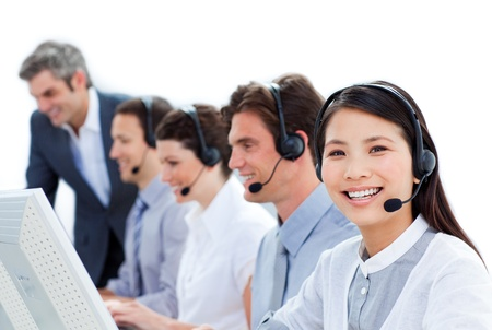 support team: Handsome business co-workers working together Stock Photo