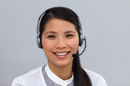 Self-assured ethnic businesswoman with headset on  photo
