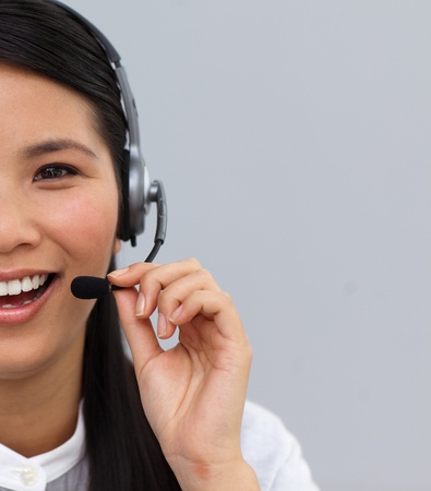 Close-up of a laughing customer service agent using headset  photo