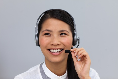 Beautiful young businesswoman using headset  photo