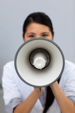 Young businesswoman shouting instructions photo