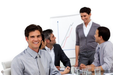 Smiling male executive at a presentation with his team  Stock Photo - 10089034