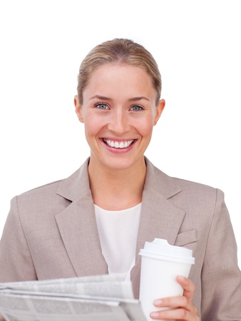 Charismatic businesswoman drinking a coffee reading a newspaper Stock Photo - 10087931