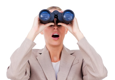 Surprised businesswoman looking through binoculars  photo