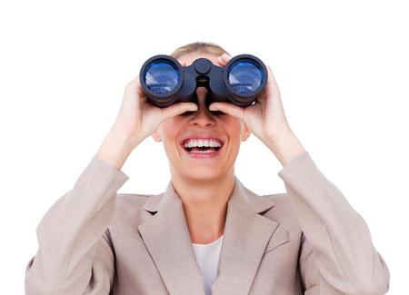 Businesswoman predicting future success through binoculars photo