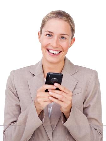 Bright businesswoman sending a text  photo