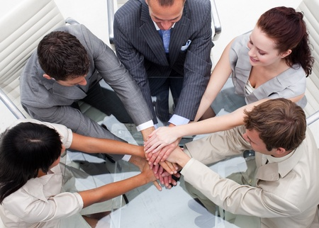 Close-up of business team with hands together. Teamwork photo