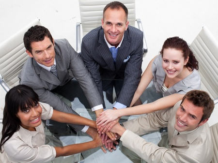 businessmeeting: High angle of business team with hands together