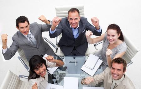 Exuberant business team celebrating a success photo