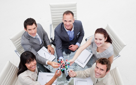 High angle of smiling business team holding molecules photo
