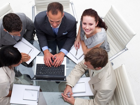 businessmeeting: High angle of businesswoman working with his colleagues