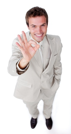 attractive charismatic: Charismatic attractive businessman pointing at the camera