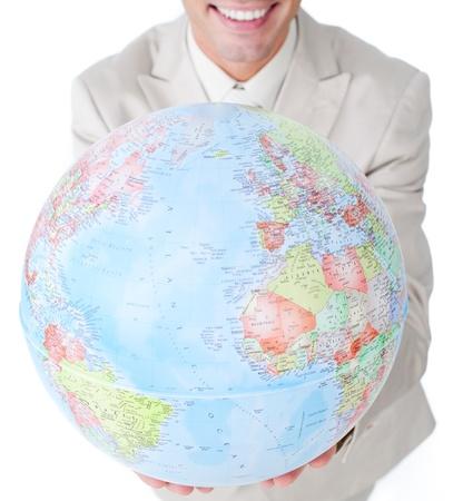 online internet presence: Smiling businessman holding a globe Stock Photo