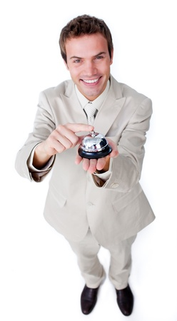Positive businessman using a bell Stock Photo - 10075456