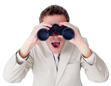 Positive businessman using binoculars photo