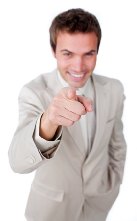 Positive businessman pointing at the camera Stock Photo - 10075507