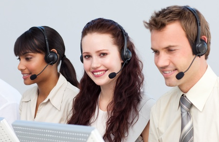 Beautiful woman working with her team in a call center Stock Photo - 10075517
